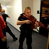 "Instructor Ken Pacheco, left, monitors Mike Deloncker, right, among other officers participating in a training exercise.<br /> New University of Colorado police were trained in an ""active harmer"" scenario, similar to a Virginia Tech shooting situation.<br /> For a video of the CU Police training exercise, go to  <a href=""http://www.dailycamera.com"">http://www.dailycamera.com</a>.<br /> December 28, 2011 / Cliff Grassmick"