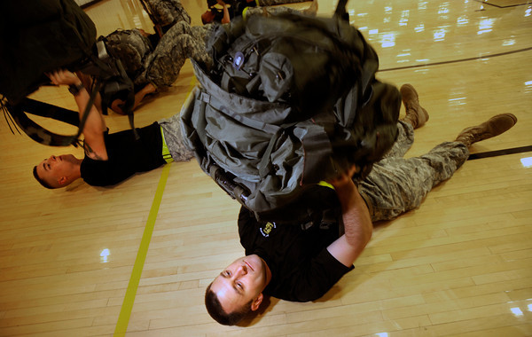 "Cadet Captain Max Perez of Alpha Company, Golden Buffalo Battalion trains with a rucksack lift very  early Thursday morning on September 8, 2011 in the CU recreation center on the University of Colorado Boulder Campus. With Perez at left is third year Cadet Robert-Josef Heitzer.<br /> FOR MORE PHOTOS AND A VIDEO OF THE TRAINING GO TO  <a href=""http://WWW.DAILYCAMERA.COM"">http://WWW.DAILYCAMERA.COM</a><br /> Photo by Paul Aiken / The Camera / September 6 2011"