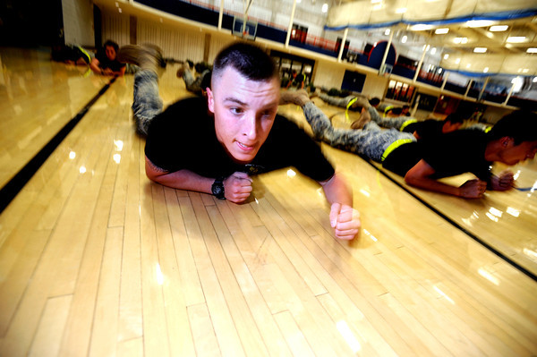 """Third year Cadet Robert-Josef Heitzer of Alpha Company, Golden Buffalo Battalion joins his fellow cadets on a floor crawl very  early Thursday morning on September 8, 2011 in the CU recreation center on the University of Colorado Boulder Campus.<br /> FOR MORE PHOTOS AND A VIDEO OF THE TRAINING GO TO  <a href=""""http://WWW.DAILYCAMERA.COM"""">http://WWW.DAILYCAMERA.COM</a><br /> Photo by Paul Aiken / The Camera / September 6 2011"""