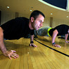 "Cadet Captain Max Perez, left,  of Alpha Company, Golden Buffalo Battalion does pushups early Thursday morning on September 8, 2011 in the CU recreation center on the University of Colorado Boulder Campus. With Perez at right is third year Cadet Robert-Josef Heitzer.<br /> FOR MORE PHOTOS AND A VIDEO OF THE TRAINING GO TO  <a href=""http://WWW.DAILYCAMERA.COM"">http://WWW.DAILYCAMERA.COM</a><br /> Photo by Paul Aiken / The Camera / September 6 2011"
