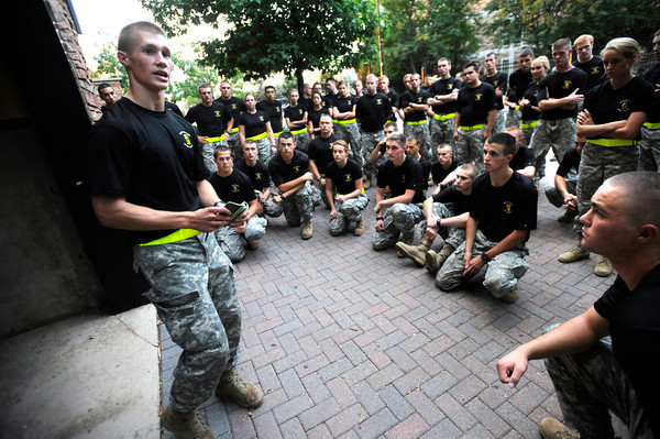 "Kevin Myhre, junior, of Alpha Company, Golden Buffalo Battalion goes over the details of some upcoming training just outside Folsom Field on the University of Colorado Boulder Campus.<br /> FOR MORE PHOTOS AND A VIDEO OF THE TRAINING GO TO  <a href=""http://WWW.DAILYCAMERA.COM"">http://WWW.DAILYCAMERA.COM</a><br /> Photo by Paul Aiken / The Camera / September 6 2011"