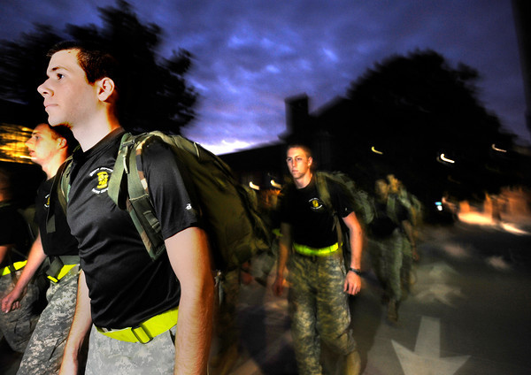 "Cadet Joseph Rodis, sophomore of Alpha Company, Golden Buffalo Battalion marches very early Thursday morning on September 8, 2011 from just outside Folsom Field to the CU recreation center for physical training on the University of Colorado Boulder Campus.<br /> FOR MORE PHOTOS AND A VIDEO OF THE TRAINING GO TO  <a href=""http://WWW.DAILYCAMERA.COM"">http://WWW.DAILYCAMERA.COM</a><br /> Photo by Paul Aiken / The Camera / September 6 2011"