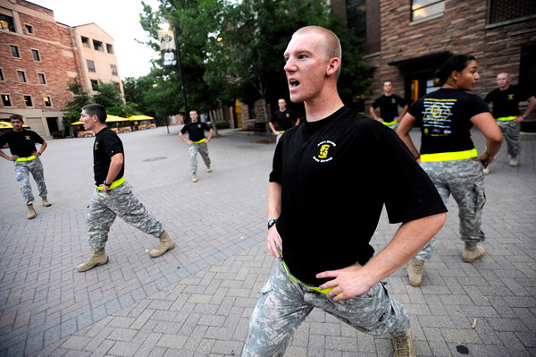 "Brenden Rothenbucher, junior, leads Alpha Company, Golden Buffalo Battalion through some very  early Thursday morning stretches on September 8, 2011 just outside Folsom Field on the University of Colorado Boulder Campus.<br /> FOR MORE PHOTOS AND A VIDEO OF THE TRAINING GO TO  <a href=""http://WWW.DAILYCAMERA.COM"">http://WWW.DAILYCAMERA.COM</a><br /> Photo by Paul Aiken / The Camera / September 6 2011"