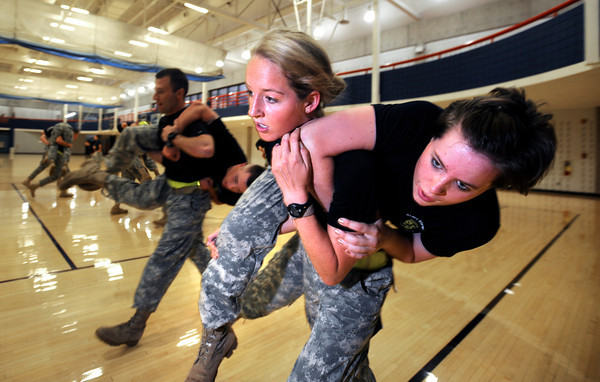 "Cadet Hannah Claybrook, carries Tara Moriarty as part of early morning PT with the Alpha Company, Golden Buffalo Battalion in the CU recreation center on the University of Colorado Boulder Campus.<br /> FOR MORE PHOTOS AND A VIDEO OF THE TRAINING GO TO  <a href=""http://WWW.DAILYCAMERA.COM"">http://WWW.DAILYCAMERA.COM</a><br /> Photo by Paul Aiken / The Camera / September 6 2011"