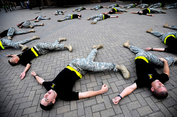 "Cadet Tucker Solt, sophomore, center, of Alpha Company, Golden Buffalo Battalion, joins a stretching regime as the cadets train very  early Thursday morning on September 8, 2011 just outside Folsom Field on the University of Colorado Boulder Campus.<br /> FOR MORE PHOTOS AND A VIDEO OF THE TRAINING GO TO  <a href=""http://WWW.DAILYCAMERA.COM"">http://WWW.DAILYCAMERA.COM</a><br /> Photo by Paul Aiken / The Camera / September 6 2011"