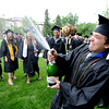 "Russ McDermott blows off some champagne on Norlin Quad before the ceremony of Friday.<br /> The ceremony will honor candidates for 6,237 degrees, including 4,830 bachelor's degrees, 994 master's degrees, 162 law degrees and 251 doctoral degrees for spring and summer.<br /> The number of degree applications for the University of Colorado is the largest in the school's history, and comes four years after the record-setting freshman class of fall 2008. That year, 5,833 freshmen enrolled, exceeding the previous record-setting class of 2006 that enrolled 5,617 freshmen. For more photos and a video, go to  <a href=""http://www.dailycamera.com"">http://www.dailycamera.com</a>.<br /> Cliff Grassmick / May 11, 2012"