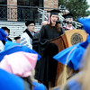 "Anna Englander sings the National Anthem at the beginning of the ceremony.<br /> The ceremony will honor candidates for 6,237 degrees, including 4,830 bachelor's degrees, 994 master's degrees, 162 law degrees and 251 doctoral degrees for spring and summer.<br /> The number of degree applications for the University of Colorado is the largest in the school's history, and comes four years after the record-setting freshman class of fall 2008. That year, 5,833 freshmen enrolled, exceeding the previous record-setting class of 2006 that enrolled 5,617 freshmen. For more photos and a video, go to  <a href=""http://www.dailycamera.com"">http://www.dailycamera.com</a>.<br /> Cliff Grassmick / May 11, 2012"