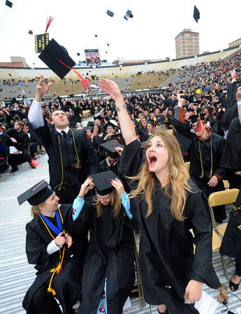 "Marissa Hoffman, left, Heather Vogel, and  Victoria Strocker, celebrate their graduation from the CU School of Journalism.<br /> The ceremony will honor candidates for 6,237 degrees, including 4,830 bachelor's degrees, 994 master's degrees, 162 law degrees and 251 doctoral degrees for spring and summer.<br /> The number of degree applications for the University of Colorado is the largest in the school's history, and comes four years after the record-setting freshman class of fall 2008. That year, 5,833 freshmen enrolled, exceeding the previous record-setting class of 2006 that enrolled 5,617 freshmen. For more photos and a video, go to  <a href=""http://www.dailycamera.com"">http://www.dailycamera.com</a>.<br /> Cliff Grassmick / May 11, 2012"