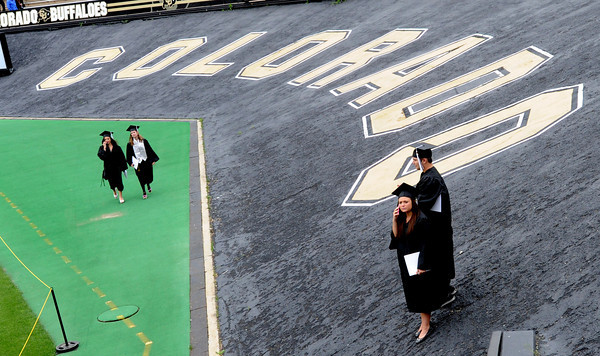 "Recent graduates  walk through Folsom Field after the ceremony.<br /> The ceremony will honor candidates for 6,237 degrees, including 4,830 bachelor's degrees, 994 master's degrees, 162 law degrees and 251 doctoral degrees for spring and summer.<br /> The number of degree applications for the University of Colorado is the largest in the school's history, and comes four years after the record-setting freshman class of fall 2008. That year, 5,833 freshmen enrolled, exceeding the previous record-setting class of 2006 that enrolled 5,617 freshmen. For more photos and a video, go to  <a href=""http://www.dailycamera.com"">http://www.dailycamera.com</a>.<br /> Cliff Grassmick / May 11, 2012"
