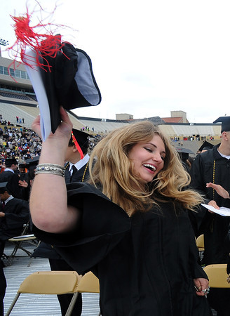 "Victoria Strocker, celebrates her graduation from the CU School of Journalism.<br /> The ceremony will honor candidates for 6,237 degrees, including 4,830 bachelor's degrees, 994 master's degrees, 162 law degrees and 251 doctoral degrees for spring and summer.<br /> The number of degree applications for the University of Colorado is the largest in the school's history, and comes four years after the record-setting freshman class of fall 2008. That year, 5,833 freshmen enrolled, exceeding the previous record-setting class of 2006 that enrolled 5,617 freshmen. For more photos and a video, go to  <a href=""http://www.dailycamera.com"">http://www.dailycamera.com</a>.<br /> Cliff Grassmick / May 11, 2012"