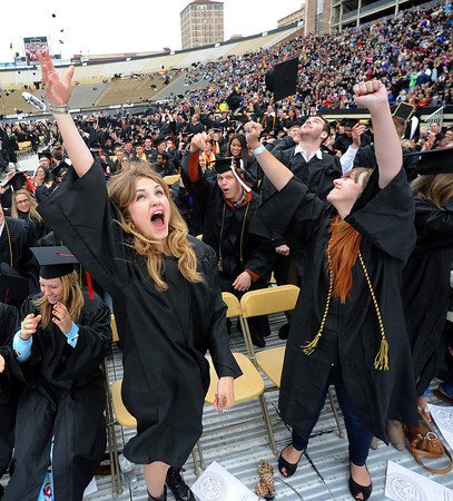 "Victoria Strocker, left, and Crystal Anderson, celebrate the announcement of the Journalism School.<br /> The ceremony will honor candidates for 6,237 degrees, including 4,830 bachelor's degrees, 994 master's degrees, 162 law degrees and 251 doctoral degrees for spring and summer.<br /> The number of degree applications for the University of Colorado is the largest in the school's history, and comes four years after the record-setting freshman class of fall 2008. That year, 5,833 freshmen enrolled, exceeding the previous record-setting class of 2006 that enrolled 5,617 freshmen. For more photos and a video, go to  <a href=""http://www.dailycamera.com"">http://www.dailycamera.com</a>.<br /> Cliff Grassmick / May 11, 2012"
