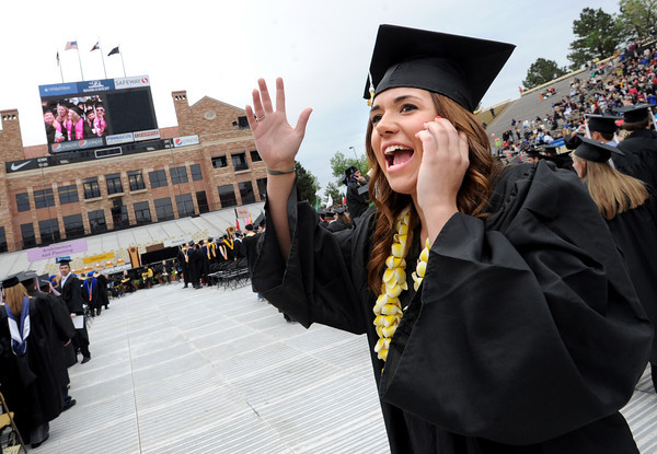 """Alex Ball is talking to friends and family just before the CU graduation ceremony.<br /> The ceremony will honor candidates for 6,237 degrees, including 4,830 bachelor's degrees, 994 master's degrees, 162 law degrees and 251 doctoral degrees for spring and summer.<br /> The number of degree applications for the University of Colorado is the largest in the school's history, and comes four years after the record-setting freshman class of fall 2008. That year, 5,833 freshmen enrolled, exceeding the previous record-setting class of 2006 that enrolled 5,617 freshmen. For more photos and a video, go to  <a href=""""http://www.dailycamera.com"""">http://www.dailycamera.com</a>.<br /> Cliff Grassmick / May 11, 2012"""