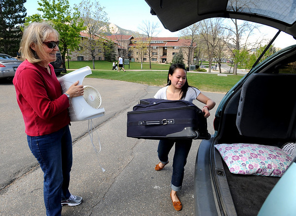 """CU students Moving out6.JPG Nina Sotkin, right, a CU freshman, loads the family van with her mother, Debra on Wednesday.<br /> University of Colorado students move out of the dorms as the school year ends. For a video of the move, go to  <a href=""""http://www.dailycamera.com"""">http://www.dailycamera.com</a>.<br /> Cliff Grassmick/ May 4, 2011"""