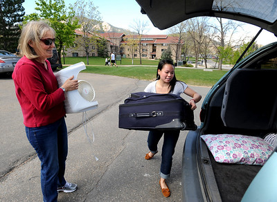 CU students Moving out6.JPG Nina Sotkin, right, a CU freshman, loads the family van with her mother, Debra on Wednesday. University of Colorado students move out of the dorms as the school year ends. For a video of the move, go to www.dailycamera.com. Cliff Grassmick/ May 4, 2011