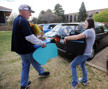 CU students Moving out45.JPG Jim Asmus, of Westminster, helps his daughter, Alicia, move out of the Kittredge dorms on Wednesday. University of Colorado students move out of the dorms as the school year ends. For a video of the move, go to www.dailycamera.com. Cliff Grassmick/ May 4, 2011