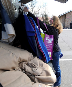 CU students Moving out69.JPG Kelsey Niemeyer loads some clothing in the family car from the Kittredge dorms on Wednesday University of Colorado students move out of the dorms as the school year ends. For a video of the move, go to www.dailycamera.com. Cliff Grassmick/ May 4, 2011