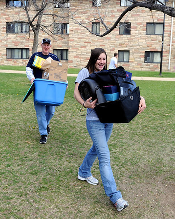 """CU students Moving out34.JPG Jim Asmus, of Westminster, helps his daughter, Alicia, move out of the Kittredge dorms on Wednesday.<br /> University of Colorado students move out of the dorms as the school year ends. For a video of the move, go to  <a href=""""http://www.dailycamera.com"""">http://www.dailycamera.com</a>.<br /> Cliff Grassmick/ May 4, 2011"""