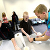 "Austin Smith, of CU Teach, at right works with from left to right Coby Hsin and Isaiah Mittan, 7th graders at Prospect Ridge Academy in Broomfield as they prepare to make tie dye t-shirts as part of  Engineers Week at IBM's Boulder campus on Tuesday morning February 19, 2013.<br /> The CU Teach program is a four-year degree/licensure program that allows students to complete an education in a mathematics or science major and fulfill the requirements for a Colorado initial teaching license in Secondary Mathematics or Secondary Science.<br /> For more photos go to  <a href=""http://www.coloradodaily.com"">http://www.coloradodaily.com</a><br /> Photos by Paul Aiken"