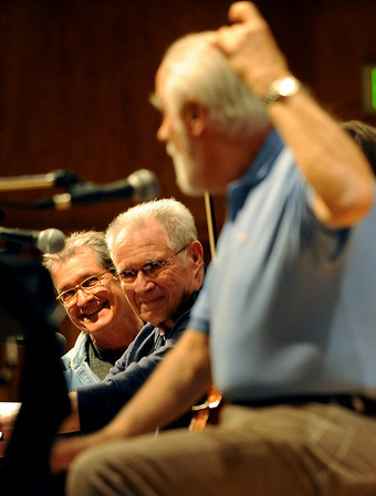 "Don Grusin, left, and his brother Dave, listen to Oscar Castro-Neves tell a story about jazz musicians during their CWA panel on Friday.<br /> One of the final highlights of the 2010 Conference on World Affairs was Dave and Don Grusin, Charlie Bisharat and Oscar Castro-Neves, talking about and plying music of Brazil.<br /> For more photos and a video of the panel, go to  <a href=""http://www.dailycamera.com"">http://www.dailycamera.com</a>.<br /> Cliff Grassmick / April 9, 2010"