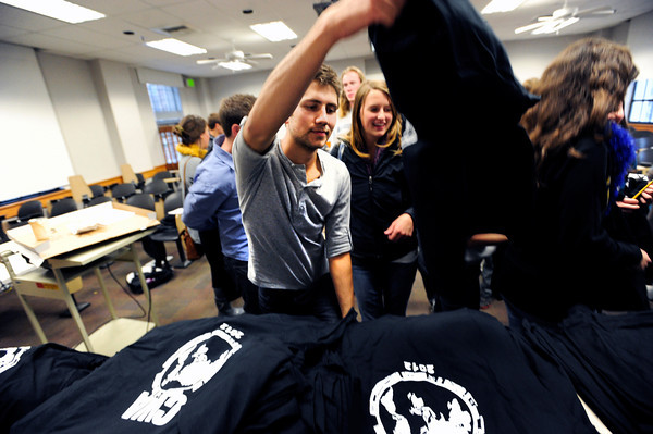 "Student volunteer Lukas Gonzales picks up his official t-shirt during a Conference on World Affairs student volunteer training session on the CU Boulder Campus on Tuesday April 3, 2012.<br /> For more photos of the training session go to  <a href=""http://www.dailycamera.com"">http://www.dailycamera.com</a><br /> Photo by Paul Aiken / The Camera"