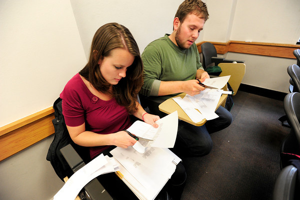 "Student Volunteers Lindsay Foss and Isaiah Rifkin cut up schedules for other student workers during a Conference on World Affairs student volunteer training session on the CU Boulder Campus on Tuesday April 3, 2012.<br /> For more photos of the training session go to  <a href=""http://www.dailycamera.com"">http://www.dailycamera.com</a><br /> Photo by Paul Aiken / The Camera"