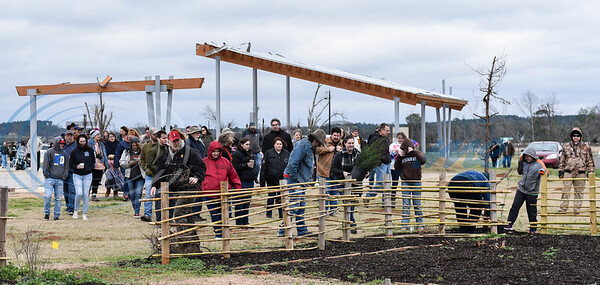 People gathered at Caddo Mounds State Historic Site near the Snake Woman's Garden on Saturday, January 11 for a re-opening ceremony after tornados destroyed the site last April. (Jessica T. Payne/Tyler Morning Telegraph)