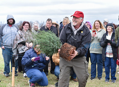Tony Souther, Caddo Mounds State Historic Site manager, smiles as he plants a cedar tree during a re-opening ceremony for the site on Saturday, January 11. (Jessica T. Payne/Tyler Morning Telegraph)