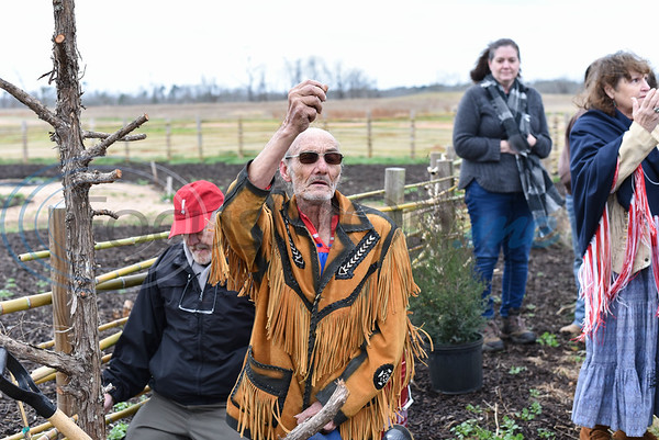 Texas Cherokee Ron Black Eagle says a prayer prior to planting a tree during a re-opening ceremony for the Caddo Mounds State Historic Site. Black Eagle traveled from Waco for the special event. (Jessica T. Payne/Tyler Morning Telegraph)