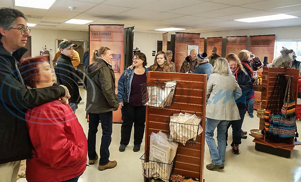 People gather inside the temporary Caddo Mounds State Historic Site Museum on Saturday, January 11 for a re-opening ceremony after tornados destroyed the site last April. (Jessica T. Payne/Tyler Morning Telegraph)