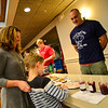 KRISTOPHER RADDER — BRATTLEBORO REFORMER<br /> Vermont Fish and Game Wardens Kelly Price and Dave Taddei serve up a cranberry and sourdough beard sampler during the 4th annual Can Cops Cook fundraiser at the American Legion, in Brattleboro, on Saturday, Jan. 26, 2019.