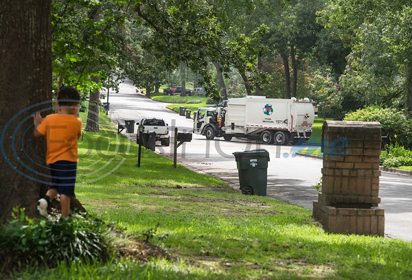 Carson Howard, 3, watches as a recycling truck  drives down his street in Tyler on Tuesday, June 30, 2020. Howard loves trash trucks, including toys and the real thing. He likes to return his neighbors' empty cans from the street twice a week.