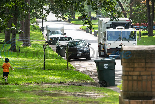 Carson Howard, 3, runs with excitement as the trash truck  drives toward his house in Tyler on Tuesday, June 30, 2020. Howard loves trash trucks, including toys and the real thing. He likes to return his neighbors' empty cans from the street twice a week.