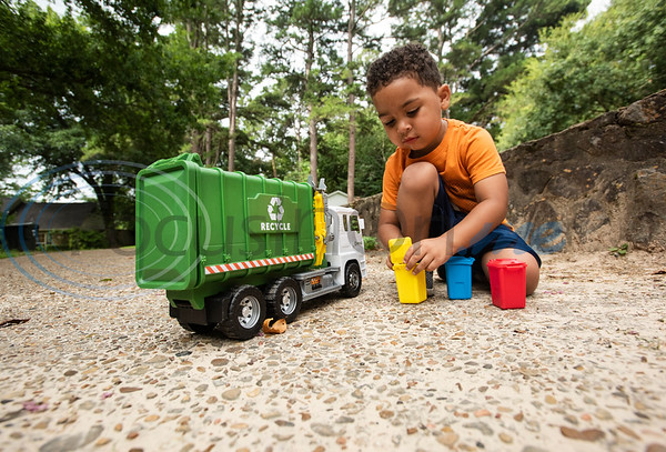Carson Howard, 3, plays with a toy trash truck as he waits outside for trash pickup to stop by his family's house in Tyler on Tuesday, June 30, 2020. Howard loves trash trucks, including toys and the real thing. He likes to return his neighbors' empty cans from the street twice a week.