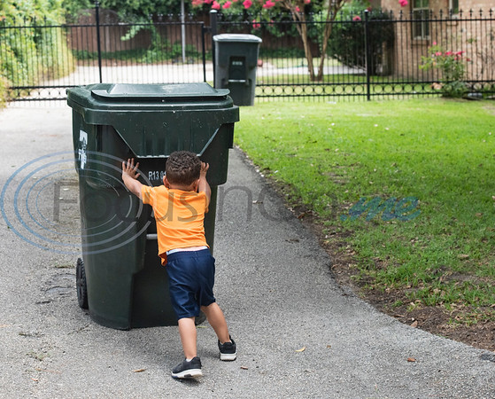 Carson Howard, 3, returns his neighbor's empty trash can after trash pickup in Tyler on Tuesday, June 30, 2020. Howard loves trash trucks, including toys and the real thing. He likes to return his neighbors' empty cans from the street twice a week.
