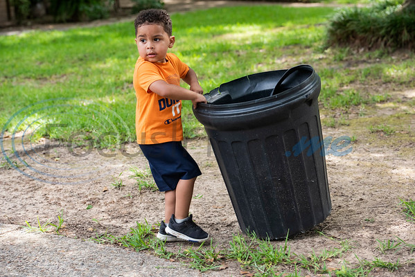 Carson Howard, 3, returns a yard waste can after pickup on Tuesday, June 30, 2020. Howard loves trash trucks, including toys and the real thing. He likes to return his neighbors' empty cans from the street twice a week.