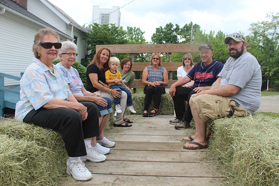 HALEE HEIRONIMUS / GAZETTE The Woodhall family, which owns 32 acres next door to the Waltz United Methodist Church, 7465 Egypt Rd., provided hayrides during the National Cancer Survivors Day Celebration.
