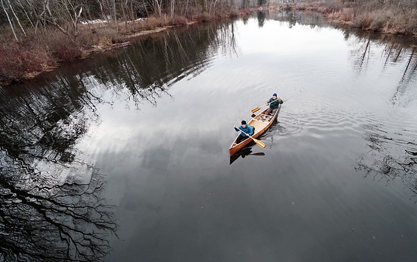 BEN GARVER — THE BERKSHIRE EAGLE<br /> Eleanor Saunder and Jim Murray canoe in  Woods pond for their first outing of the year.