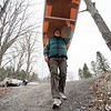 BEN GARVER — THE BERKSHIRE EAGLE<br /> Jim Murray carries his fiberglass canoe to the dock at Woods pond for his first outing of the year.