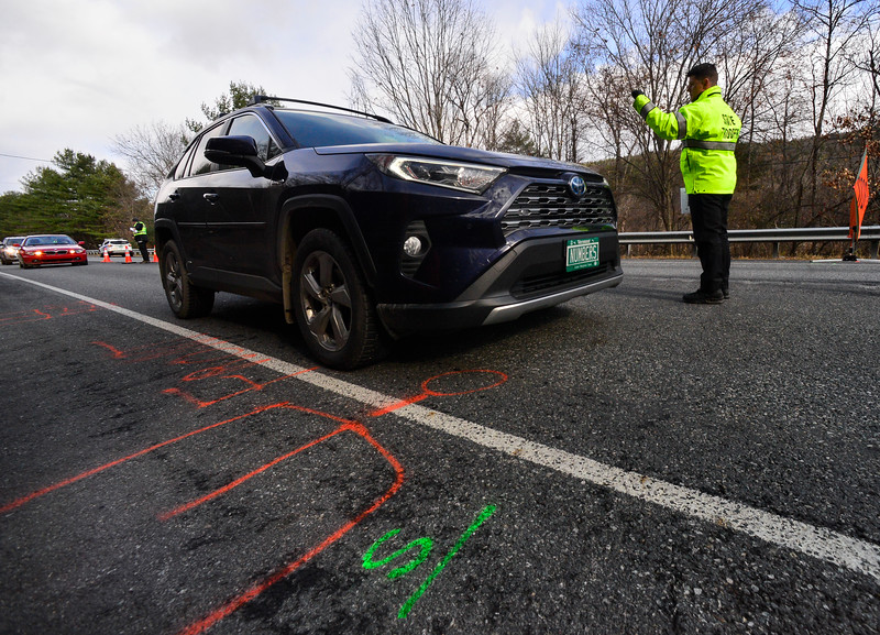 KRISTOPHER RADDER — BRATTLEBORO REFORMER<br /> Marking on Route 103 where the Katsiroubas Brothers Wholesale Fruit & Produce truck was found last Friday, as Vermont State Police investigators set up a check point as they talk to motorists whether they saw anything leading up to the homicide.