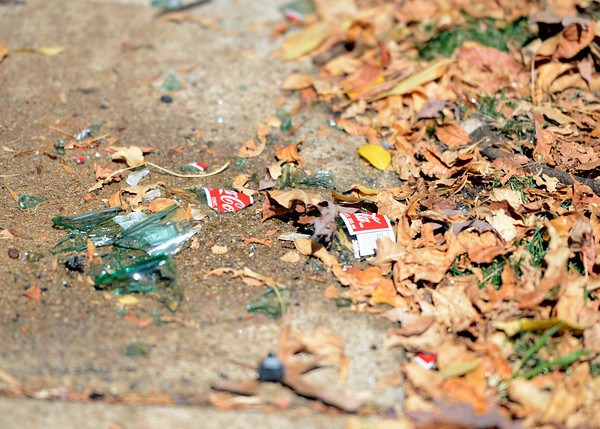 A broken Coca-Cola bottle at the scene of car versus pedestrian accident on Wednesday, Oct. 3, in the parking lot of St. Aidan's Episcopal Church on 2425 Colorado Avenue in Boulder. The man who was hit by the car was eating lunch at a table when a woman crashed into a food truck and then the table where the man was sitting.<br /> Jeremy Papasso/ Camera