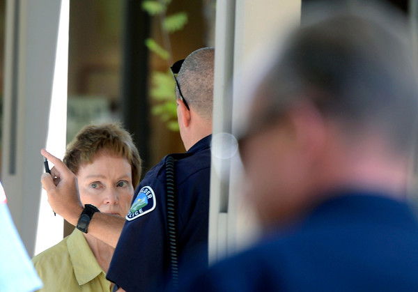 Boulder Police give a sobriety test to Brenda Geers, of Boulder, after she crashed her SUV into a man eating lunch at a table on Wednesday, Oct. 3, in the parking lot of St. Aidan's Episcopal Church on 2425 Colorado Avenue in Boulder. The man who was hit by the car was eating lunch at a table when a woman crashed into a food truck and then the table where the man was sitting.<br /> Jeremy Papasso/ Camera
