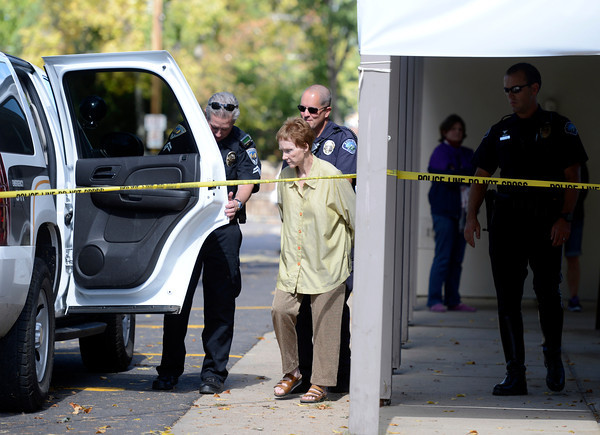 Boulder Police take Brenda Geers, of Boulder, into custody for possible drunk driving after crashing her SUV into a man eating lunch at a table on Wednesday, Oct. 3, in the parking lot of St. Aidan's Episcopal Church on 2425 Colorado Avenue in Boulder. The man who was hit by the car was eating lunch at a table when a woman crashed into a food truck and then the table where the man was sitting.<br /> Jeremy Papasso/ Camera