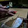 KRISTOPHER RADDER — BRATTLEBORO REFORMER<br /> Art Costa, of Putney, cuts out claws from cardboard for his sculpture.