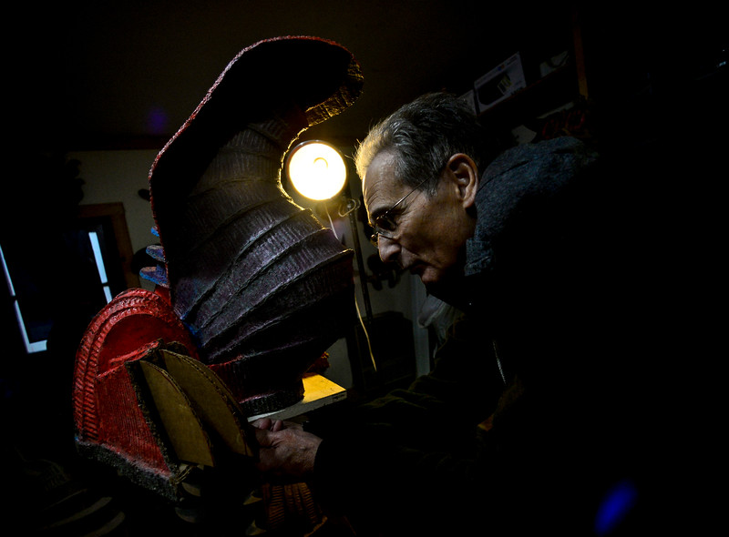 KRISTOPHER RADDER — BRATTLEBORO REFORMER<br /> Art Costa, of Putney, sets the claws inside the footing of his sculpture.