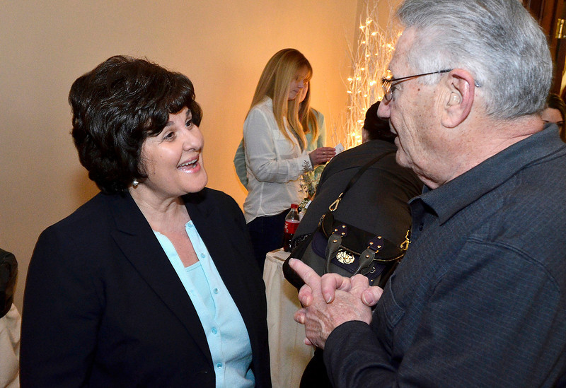 Mike McMahon - The Record, State Senator Kathy Marchione talks with Tom Miglio of Ghent at The Women's Concealed Carry fashion show at the Birch Hill in Schodack, Saturday March 29, 2014