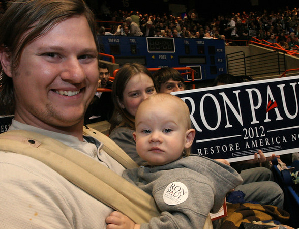 Nathan Haskins and his a-little-more-than-indifferent son, Isaac during the Idaho caucus in Boise.