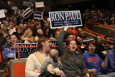 Nathan Haskins, holding his son Isaac, looks over at his wife, Rebekah as they voice their support for Ron Paul.