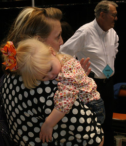 The evening wore on for everyone and some were not able to keep up.  Zoe Lombard, 2 1/2, sleeps on her mom's shoulder.