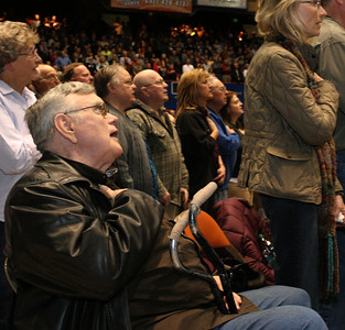 Bill Mitchell sings the National Anthem along with those gathered at the Boise, Idaho GOP caucus on Super Tuesday.