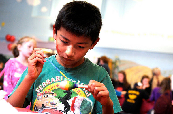"""Escuela Bilingüe Pioneer third-grader Luis Franco paints his maraca during a celebration for César Chávez day on Friday, April 1, at Escuela Bilingüe Pioneer Elementary school in Lafayette. For more photos and a video of the march go to  <a href=""""http://www.dailycamera.com"""">http://www.dailycamera.com</a><br /> Jeremy Papasso/ Camera"""